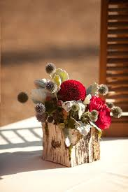 Floral Arrangement Using Carved Wood As A Container