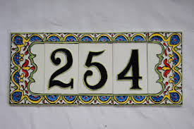 this is a brand new decorative house number tiles 3 digit numbers