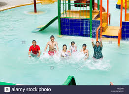 Group Indian Happy Family Waterpark Swimming Pool Bathing Enjoy Splash Water