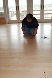 Christopherson Wood Floor Employee Ron Unrein Installing Cut Nails In An Antique Eastern White Pine With A Natural Finish