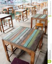 Row Of Wooden Colorful Tables And Chairs Of A Cafe Or Restaurant In ... Empty Table Chair Restaurant Boost Color Stock Photo Edit Now Ding Set For Dinner Room Small Cherry Style Contemporary Fniture Kids And Cafe Bistro Tables Chairs Droughtrelieforg Modern Industrial Bar Stools Rustic And Flash 36inch Round With Four Products Vector Table Chair Two Flat Icon Isolated Fniture Side Stool Supply Discount Find More For Sale At Up To 90 Coffee Terrace With Classic Shop Blur