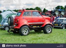100 Mini Monster Truck A Style Minor Car On Show At A Summer Fair In