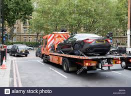 MASERATI SPORTS CAR ON A BREAKDOWN TRUCK, CENTRAL LONDON Stock Photo ...