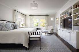 Example Of A Classic Dark Wood Floor Bedroom Design In Minneapolis With White Walls