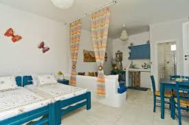 Decorating Studio Apartment Colorful Carpet Yellow Door In Dining Room Set Cozy Bathtub Modern White Corner Sofa