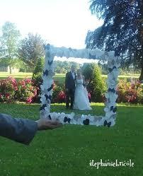 idée de déco cadre papillon et coeur pour photo de mariés