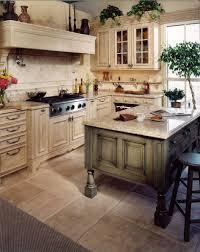distressed green kitchen island with birdcage kitchen cabinet