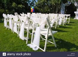 White Decorated Chairs On A Green Lawn. Chairs Set In Rows ... 16 Easy Wedding Chair Decoration Ideas Twis Weddings Beautiful Place For Outside Wedding Ceremony In City Park Many White Chairs Decorated With Fresh Flowers On A Green Can Plastic Folding Chairs Look Elegant For My Event Ctc Ivory Us 911 18 Offburlap Sashes Cover Jute Tie Bow Burlap Table Runner Burlap Lace Tableware Pouch Banquet Home Rustic Decorationin Spandex Party Decorations Pink Buy Folding Event And Get Free Shipping Aliexpresscom Linens Inc Lifetime Stretch Fitted Covers Back Do It Yourself Cheap Arch