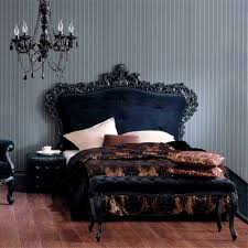 gothic bedroom with purple walls and wrought iron bed frame