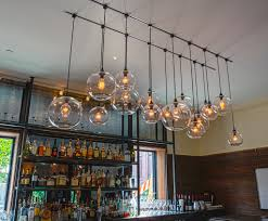 Groups Of Different Size Globe Sphere Pendant Bar Lights Made From Glass Clear Transparent Adorable Glow