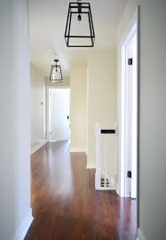 three oversized lantern lights for the hallway house
