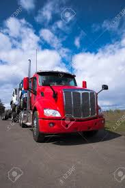 A Powerful Modern Big Rig Red Semi Truck Carries Other Articulated ...