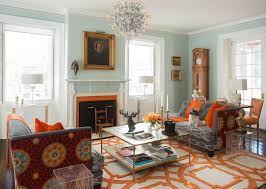 light blue wall living room with coffee table glass door