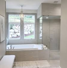 open concept bathrooms with large glass walls and doors