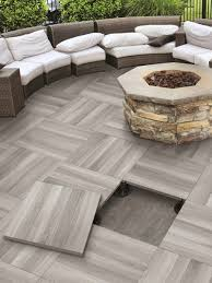 Elevated patio tile floor by Serenissima with a fire pit installed