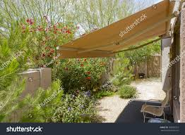 Arizona Backyard Automatic Retractable Awning Extra Stock Photo ... Outdoor Magnificent Cost To Add Covered Patio 12x16 Cover Unique Fixed Awnings With Regal Home Kreiders Canvas Service Inc Awning For Backyard Retractable Canopy Or Whats The In Massachusetts Sondrini Enterprises Shade Best Images Collections Hd Gadget Ideas Fabric Full Image Terrific Features Carports Windows Backyards Ergonomic Exterior Alinum Elegant Sunesta Innovative Openings