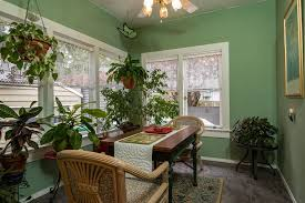 Green Tropical Dining Room With Tiled Floor And Ceiling Fan