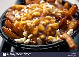 poutine cuisine poutine at la province restaurant in montreal canada stock