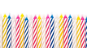 Some striped birthday candles on white background stock photo
