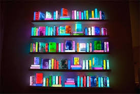 entire accent wall colorful books led lighting on design