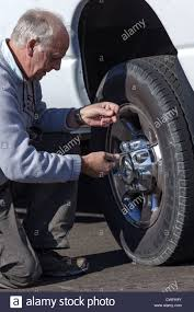 Senior Man Kneeling Beside A White Pick-up Truck Checking Pressure ... Amazoncom Accutire Ms5515b Truck And Rv Digital Tire Gauge With Truckrv Dual Head Walmartcom Dynatex Tyre Pssure Inflator Air Gun Compressor Dial 14 Haltec Gaugebrass11 In L 48wc36ga1351 Grainger Tiretek Truckpro Heavy Tread Depth Metric Standard Measures Tester 254mm Car Suv 0100 Psi Right Angle Chuck Fixm Portable 150psi Gauges Tires Care The Home Depot Lcd Tool Motorcycle Using A Wear On Stock Photo Picture And Professional