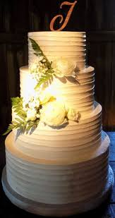 4 Tier Rustic Buttercream Wedding Cake Decorated With Fresh Flowers