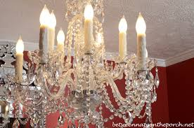 transform an ordinary chandelier with resin candle covers and silk