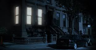 A Nighttime Exterior Establishing Shot Of The First Floor Typical Brooklyn Brownstone Residential Home
