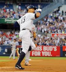 Alex Rodriguez of the Yankees reacts after career hit No 3 000 a first