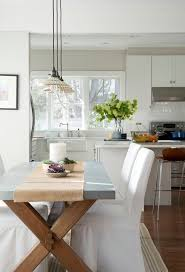 bright trestle table in dining room style with concrete