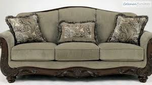 Claremore Antique Sofa And Loveseat by Martinsburg Meadow Living Room Collection From Signature Design By