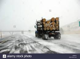 100 Eastern Truck And Trailer Logging Truck On Icy Road During Winter Storm In Oregon