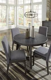 The Besteneer Dark Gray 5 Pc. Round Dining Table & 4 Upholstered ... Trisha Yearwood Home Music City Hello Im Gone Ding Room Table Grey Griffin Cutback Upholstered Chair Along With Dark Wood Amazoncom Formal Luxurious 5pc Set Antique Silver Finish Tribeca Round And 2 Upholstered Side Chairs American Haddie Light Tone 4 Value Hooker Fniture Corsica Rectangle Pedestal Matisse With W Ladder Back By Paula Deen Vienna Merlot Kayla New