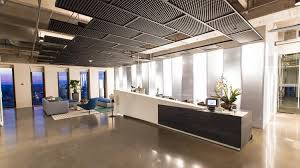 The Reception Area On 20th Floor Includes A Lounge Seating And Technology To Sign