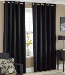 spacious black bedroom space with large blackout curtains bed bath