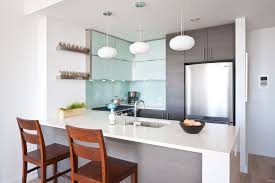 Light Blue Subway Tile contemporary kitchen with breakfast bar u0026 glass panel in long