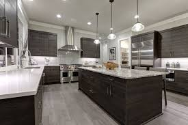 U Shape Kitchen Layout With Island Dark Cabinetry And Light Countertops