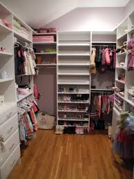 u shaped white wooden closet with white wooden shelves and shoes