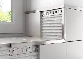 image result for white tiles brushed steel trim bathroom