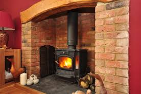 Photo Of Rustic Warm Red Brick With Bare Floorboards Fireplace Log Burner Wood