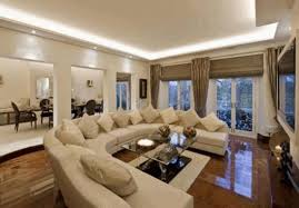 Round Coffee Table With Stools Underneath by Wall Paintings For Living Room White Stone Center Table As Decor