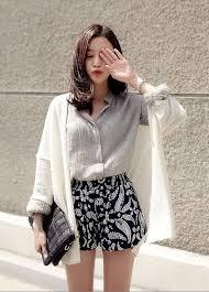 Grey Shirt And Patterned Shorts