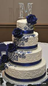 c145ec43bab00c3afede614a4278ee45 Navy blue white and bling themed wedding cake