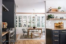 Navy And White Kitchen With Open Shelving To The Dining Room Mid Century