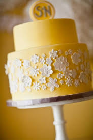 love this yellow cake with perfect little white flowers The flavor needs to be orange or lemon