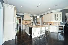 Traditional Kitchen With White Sand Granite Counters And Cabinets
