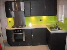 Small L Shape Black Kitchen Cabinets And Lime Green Ceramic Tiles Backsplash Also White Countertop