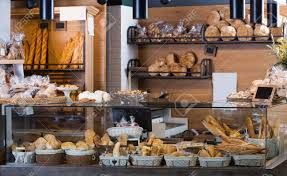 Buns Baguettes And Other Fresh Bread At Bakery Display