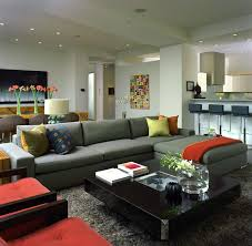 stylish living room involving gray sectional sofa combined with
