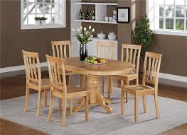 basic bare wood oval dining table with simple side dining chairs